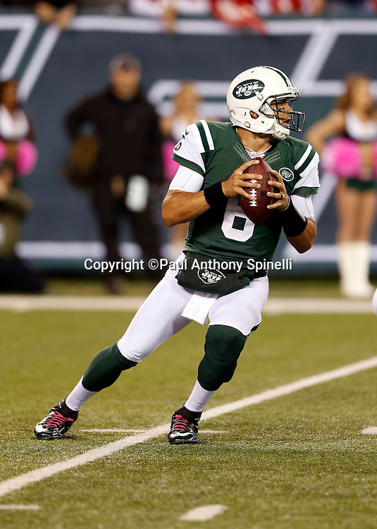 New York Jets quarterback Mark Sanchez (6) drops back to pass during the NFL week 5 football game against the Houston Texans on Monday, Oct. 8, 2012 in East Rutherford, N.J. The Texans won the game 23-17. ©Paul Anthony Spinelli