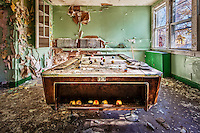 An abandoned pool table inside of a historic hospital in the Catskills of New York.