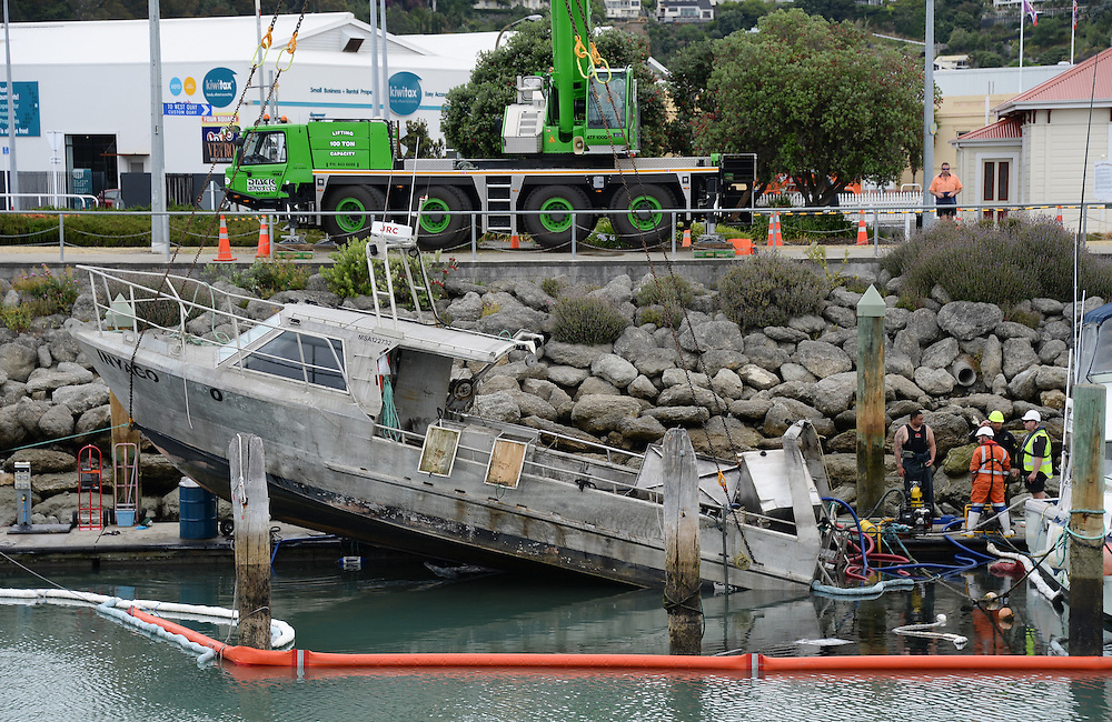 "Napier fishing boat ""Inyago"" being retrieved from the Iron Pot Marina after it sunk overnight, Napier, New Zealand, Monday, December 19, 2016. Credit:SNPA / Bruce Jenkins"