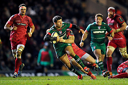 Ben Youngs of Leicester Tigers is tackled in possession - Photo mandatory by-line: Patrick Khachfe/JMP - Mobile: 07966 386802 16/01/2015 - SPORT - RUGBY UNION - Leicester - Welford Road - Leicester Tigers v Scarlets - European Rugby Champions Cup
