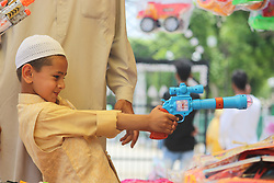 June 16, 2018 - Srinagar, Jammu and kashmir, India - Children's seen having good time on the eve of Eid. Children's dressing in kurta's pilayi with toy guys outside the dargah hazratbal today on the eve of Eid. (Credit Image: © Arfath Naseer/Pacific Press via ZUMA Wire)