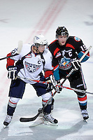 KELOWNA, CANADA, OCTOBER 5: Justin Feser #22 of the Tri City Americans is checked by Colton Sissons #15 of the Kelowna Rockets  on October 5, 2011 at Prospera Place in Kelowna, British Columbia, Canada (Photo by Marissa Baecker/shootthebreeze.ca) *** Local Caption ***Justin Feser;Colton Sissons;