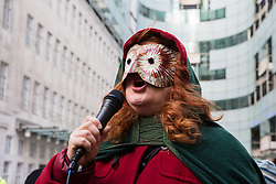London, UK. 21st December, 2018. A woman addresses environmental campaigners from Extinction Rebellion protesting outside Broadcasting House against the lack of coverage by the BBC of the climate change crisis.