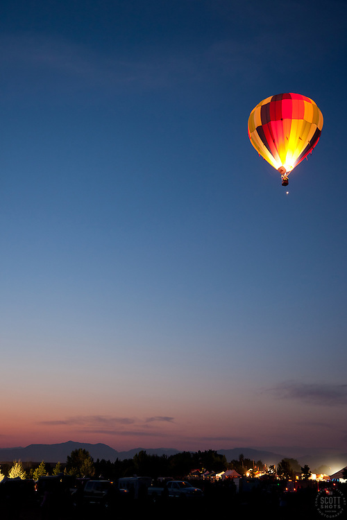 """Dawn Patrol 5"" - Photograph of a lit up hot air balloon flying over Reno during Dawn Patrol at the 2011 Great Reno Balloon Race."