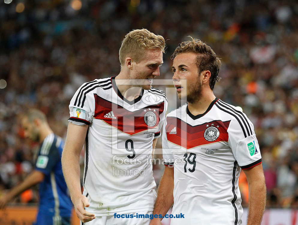 Germany's Mario G&ouml;tze celebrates scoring their first goal with team mate Andr&eacute; Schurrle during the 2014 FIFA World Cup Final match at Maracana Stadium, Rio de Janeiro<br /> Picture by Andrew Tobin/Focus Images Ltd +44 7710 761829<br /> 13/07/2014