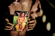 Evelyn Alpha carries a photo of her daughter Evelyn who died, 7 months pregnant, from complications with Hepatitis while prematurely delivering her baby in April 2010. Evelyn was working with the grassroots organization Amazonian Initiative Movement in Lunsar, Sierra Leone - and tried to raise awareness in villages about maternal health and good practice during delivery as well as trying to prevent Female Genital mutilation.<br /> Her mother, a nurse, is still so devasted that she lost her daughter that she cannot bear visit her grave and has great difficulties talking about her daughter: &quot;Everything I knew and she knew was not enough to save her!&quot;