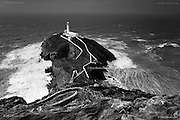 South Stack lighthouse, Holy Island, Anglesey, Ynys Môn. c1809 - Electrified in 1938 - Automated in 1984. 440 steps lead from the 200ft cliff top down to the bridge across the gorge below. We can also see here the RSPB Bird watching tower called Ellin's Tower.