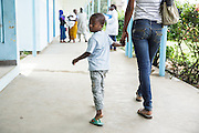 Junior Karampire, 5, who suffers from recurring ear infections, and his mother Kadidiatou Sy, 27,walk through the Koumassi General Hospital as they head to the lab for a test in Abidjan, Cote d'Ivoire on Friday July 19, 2013.