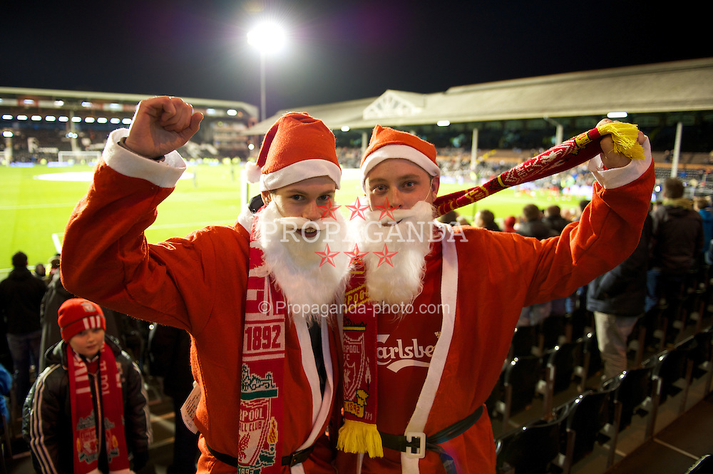 LONDON, ENGLAND - Monday, December 5, 2011: Liverpool supporters dressed as Father Christmas in the away end before the Premiership match against Fulham at Craven Cottage. (Pic by David Rawcliffe/Propaganda)