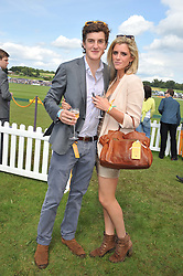 The HON.PERRY PEARSON and ANNABEL SIMPSON at the 2012 Veuve Clicquot Gold Cup Final at Cowdray Park, Midhurst, West Sussex on 15th July 2012.