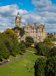 View of luxury Balmoral Hotel on Princes Street and Princes Street Gardens below in Edinburgh, Scotland, United Kingdom
