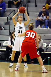 10 January 2009: Trapped by Carlie Janowiak, Nikki Preston looks for an open team mate. The Illinois Wesleyan Titans, ranked #1 in the latest USA Today/ESPN poll, take down the Lady Reds of Carthage and remain undefeated,  2-0 in the CCIW and over all to 12-0. This is the first time in the history of the Lady Titans Basketball they have been ranked #1 The Titans and Lady Reds played in the Shirk Center on the Illinois Wesleyan Campus in Bloomington Illinois.