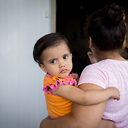 OCTOBER 18 - LARES, PUERTO RICO - <br /> Kamila Rubi Rios Beniquez, 1, held by her mother Astrid Beniquez in the Seburuquillo neighborhood in Lares.<br /> (Photo by Angel Valentin for NPR)