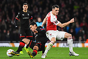 Rennes Benjamin Andre (21) and Arsenal Midfielder Granit Xhaka (34) battle for the ball during the Europa League round of 16, leg 2 of 2 match between Arsenal and Rennes at the Emirates Stadium, London, England on 14 March 2019.