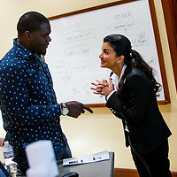 MIAMI, FL - June 24, 2015 -- Former NFL player Tommie Harris talks with the professor as he participates in a Legal & Ethical Implications of Executive Decision Making class taught by Professor Patricia Abril at the University of Miami as part of their Miami Executive MBA for Artists & Athletes program on Wednesday, June 24, 2015.  (PHOTO / CHIP LITHERLAND)
