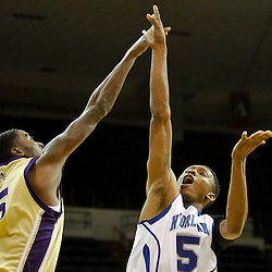 November 27, 2011; New Orleans, LA; New Orleans Privateers guard Antonio Holmes (5) shoots over Alcorn State Braves forward KeDorian Sullivan (35)during the first half of a game at the Lakefront Arena.  Mandatory Credit: Derick E. Hingle-US PRESSWIRE