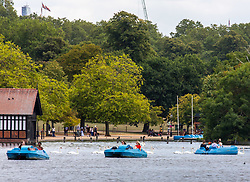 © Licensed to London News Pictures. 17/07/2020. London, UK. Members of the public enjoy the sunshine in a pedalo on the Serpentine in Hyde Park as weather forecasters predict 28c for the end to the week with rain on Sunday. As Prime Minister Boris Johnson calls for Britons to return to working in offices to help local service industries and the economic recovery. Photo credit: Alex Lentati/LNP