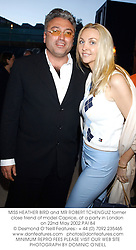 MISS HEATHER BIRD and MR ROBERT TCHENGUIZ former close friend of model Caprice, at a party in London on 22nd May 2002.	PAI 84