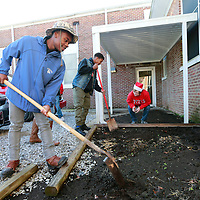 Thomas Wells | BUY AT PHOTOS.DJOURNAL.COM<br /> Joseph Nabors, 14, left, and classmate Jemarius Kennedy, 15, begin form a new planting bed at Plantersville Middle School as part of their Masterpiece program.