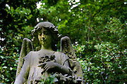Ornamental grave statue in Highgate Cemetery London