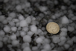 © Licensed to London News Pictures . 09/11/2013 . Manchester , UK . A blanket of freshly fallen, large hail stones covers the streets in Salford . A freak hail storm in Manchester covers the streets with large hailstones as loud rolling thunder is heard . Photo credit : Joel Goodman/LNP