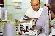 Machinist sewing in a knitwear factory....