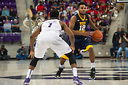 FORT WORTH, TX - JANUARY 4: Tarik Phillip #12 of the West Virginia Mountaineers brings the ball up court against the TCU Horned Frogs on January 4, 2016 at Ed and Ray Schollmaier Arena in Fort Worth, Texas.  (Photo by Cooper Neill/Getty Images) *** Local Caption *** Tarik Phillip