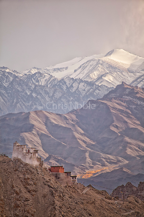 Tsemo Fort, Tsemo Gompa and the Zanskar Mountains above the town of Leh Ladakh, India.