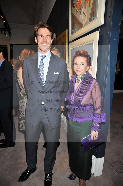 CROWN PRINCE PAVLOS OF GREECE and CHRISANTHY LEMOS at a party to celebrate the publication of Elena Makri Liberis's book 'Every Month, Same day' held at Sotheby's, 34-35 New Bond Street, London on 5th May 2009.