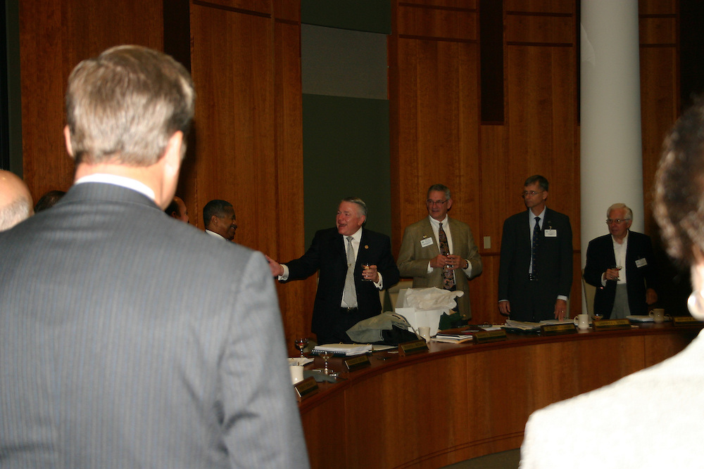 Schoonover at Trustees meeting. Schoonover Center drawing: Photo w/dean :