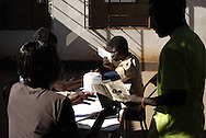 Patients get blood pressure taken and updates health booklets at the Tariro Clinic, Howard Hospital, Zimbabwe, 2010.