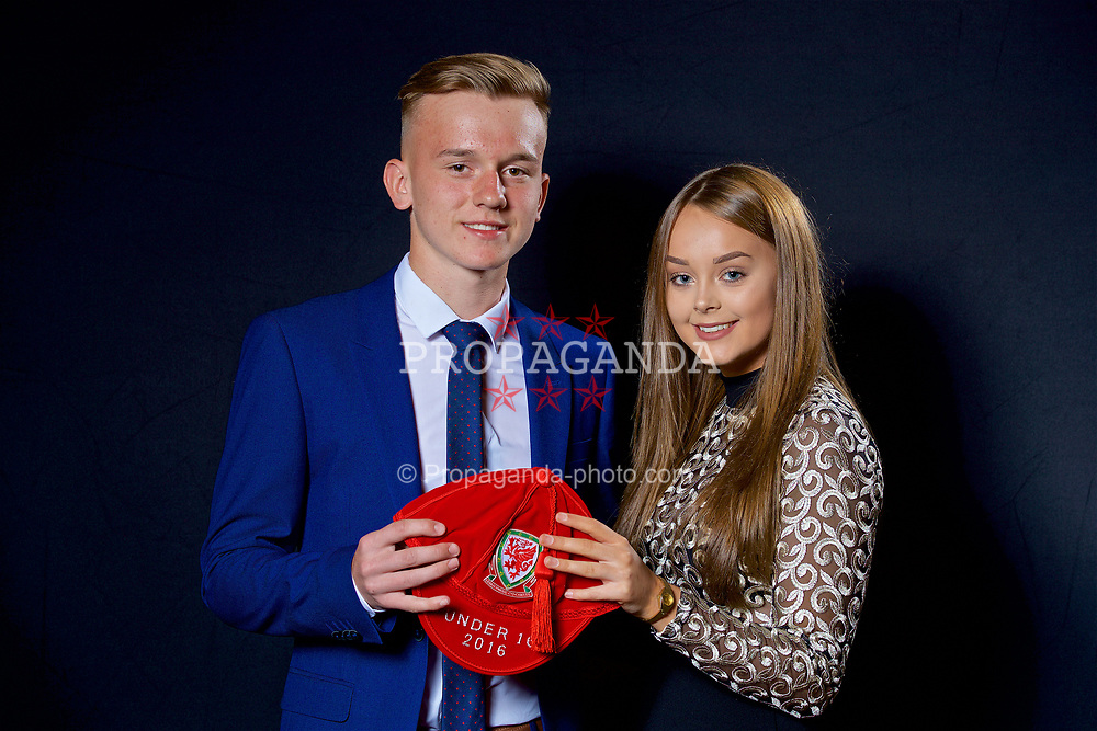 NEWPORT, WALES - Saturday, May 27, 2017: Isaak Davies and his family with his Under-16 Wales cap at the Celtic Manor Resort. (Pic by David Rawcliffe/Propaganda)