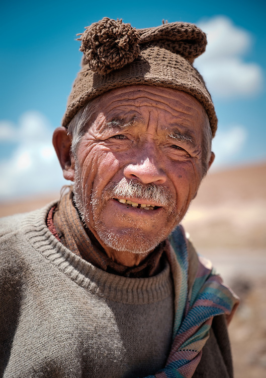 MARAS, PERU - CIRCA OCTOBER 2015:  Shepherd close to the town of Maras, a small village in the Cusco region known as Sacred Valley