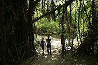 Two young boys walk along the a path that serves as the main road on Isla Grande, one of the islands in an archipelago known as Islas del Rosario, about 35km southwest of Cartagena, on Colombia's Caribbean coast on January 2, 2009. (Photo/Scott Dalton)