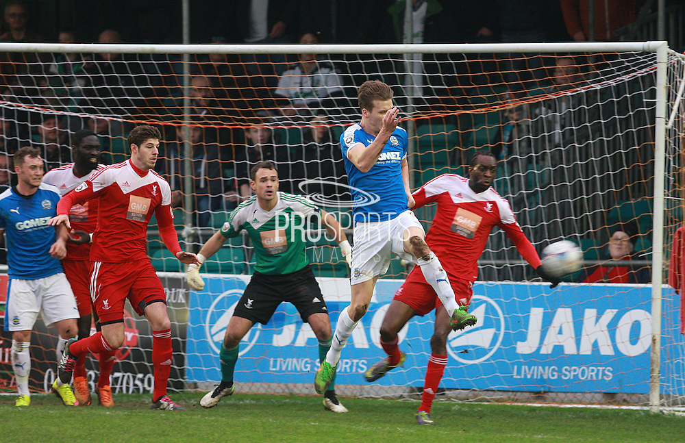 Dover defender Sean Raggett attacks a corner during the FA Trophy match between Whitehawk FC and Dover Athletic at the Enclosed Ground, Whitehawk, United Kingdom on 12 December 2015. Photo by Bennett Dean.