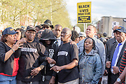 Baltimore, Maryland - April 21, 2015: Freddie Gray's mother, middle, surrounded by family members and supporters during a protest march to the Baltimore Police Department's West Precinct Tuesday April 21, 2014. Her people were aggressively protective of her, not allowing her to speak to the press. She later covered her face. <br /> <br /> CREDIT: Matt Roth for The New York Times<br /> Assignment ID: 30173645A