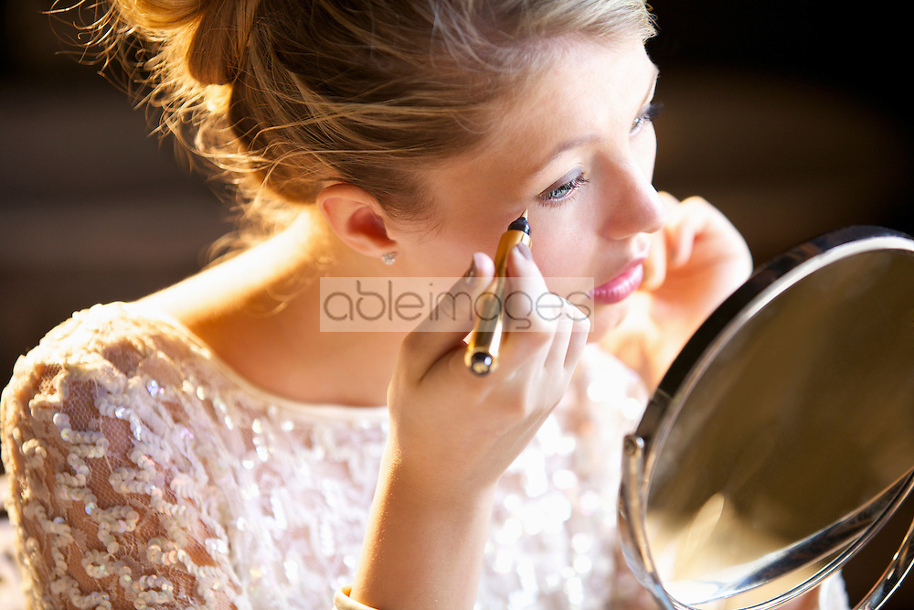 Young Woman Applying Concealer