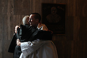 "Marist Catholic High School Senior Joe Ward (r) receives a congratulatory hug from an attendee of a recently-ended mass at Holy Name Cathedral that Ward conceived for Catholic high schools in the diocese of Chicago, Joliet, and Rockford. Chicago Archbishop Francis Cardinal George lead the mass celebration dedicated to the theme ""A Call To Serve""."