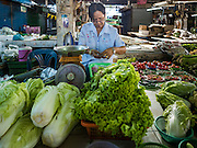 31 DECEMBER 2015 - BANGKOK, THAILAND: A produce vendor in Bang Chak Market. The market is supposed to close permanently on Dec 31, 2015. The Bang Chak Market serves the community around Sois 91-97 on Sukhumvit Road in the Bangkok suburbs. About half of the market has been torn down. Bangkok city authorities put up notices in late November that the market would be closed by January 1, 2016 and redevelopment would start shortly after that. Market vendors said condominiums are being built on the land.          PHOTO BY JACK KURTZ