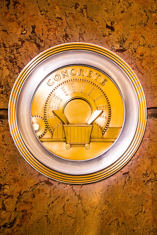 A brass, Art Deco medallion, or roundel, on the Empire State Bulding's marble-lined lobby -- one of 11 such roundels, each honoring a different technolgy or craft essential to the construction of the great building.