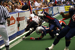 14 April 2007: Dion Brown and Dorian pitts push ball carier Muhammad Abdulqaadir out of bounds during a United Indoor Football League game that pitted the RiverCity Rage who won 29-11 against the Bloomington Extreme at the U.S. Cellular Coliseum in Bloomington Illinois..