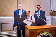 07 NOVEMBER 2012 - BANGKOK, THAILAND:  A Thai high school student stands with  cardboard cutouts of Mitt Romney and President Barrack Obama at the US Embassy's election watch party in Bangkok. US President Barack Obama won a second term Tuesday when he defeated Republican Mitt Romney. Preliminary tallies gave the President more than 300 electoral votes, well over the 270 needed to win. The election in the United States was closely watched in Thailand, which historically has very close ties with the United States. The American Embassy in Bangkok sponsored an election watching event which drew thousands to a downtown Bangkok hotel. American Democrats in Bangkok had their own election watch party at a restaurant in Bangkok.      PHOTO BY JACK KURTZ