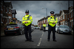 April 28, 2017 - London, London, United Kingdom - Image ©Licensed to i-Images Picture Agency. 28/04/2017. London, United Kingdom. ..Pictured are police at the scene on Harlesden Road, Willesden, north-west London, where a woman  was shot during a terror raid yesterday evening...Picture by Ben Stevens / i-Images (Credit Image: © Ben Stevens/i-Images via ZUMA Press)
