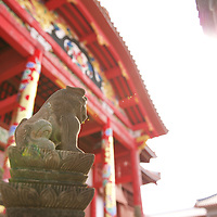 Reflecting on the Ryukyu kingdom, a Shisa Lion is bathed in sunlight on a fall day at Shuri-jo