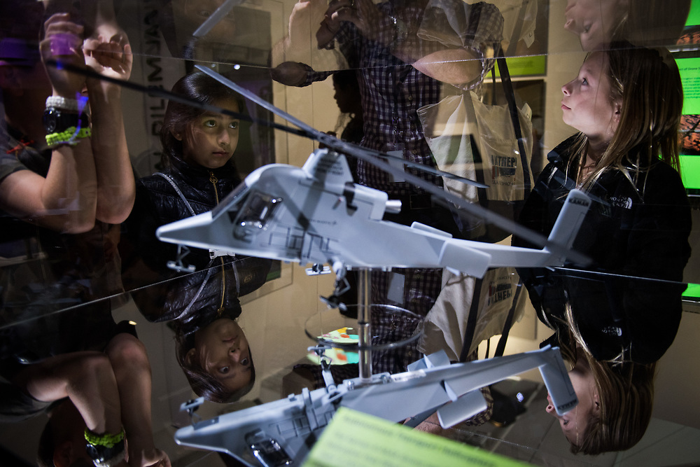 "30206010A - DRONES - Students from Kings Road School in Madison, NJ look at a model of the Kaman K-Max drone helicopter at the ""Drones: Is the Sky the Limit?"" exhibit at the Intrepid Sea, Air, and Space Museum in New York, NY on May 9, 2017."