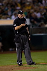 OAKLAND, CA - SEPTEMBER 19:  MLB umpire Chris Conroy #98 stands on the field during the seventh inning of an interleague game between the Oakland Athletics and the Philadelphia Phillies at O.co Coliseum on September 19, 2014 in Oakland, California. The Oakland Athletics defeated the Philadelphia Phillies 3-1. (Photo by Jason O. Watson/Getty Images) *** Local Caption *** Chris Conroy