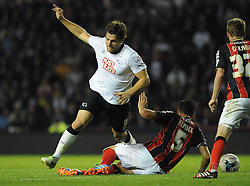 Derby County's Chris Martin is tackled by Bournemouth's Tommy Elphick - Photo mandatory by-line: Dougie Allward/JMP - Mobile: 07966 386802 - 30/09/2014 - SPORT - Football - Derby - Pride Park - Derby County v AFC Bournemouth - Sky Bet Championship