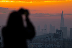 © Licensed to London News Pictures. 21/04/2018. London, UK. The sun sets over London as seen from Greenwich Observatory, after a period of hot weather when temperatures reached 29 degrees. Photo credit : Tom Nicholson/LNP