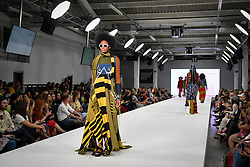 © Licensed to London News Pictures. 04/06/2018. London, UK.  A model presents a look by Nyree Hall from Birmingham University on day two of Graduate Fashion Week taking place at the Old Truman Brewery in East London. The event presents the graduation show of up and coming fashion designers from UK and international universities.  Photo credit: Stephen Chung/LNP
