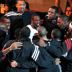 Jun 21, 2012; Miami, FL, USA; The Miami Heat huddle around shooting guard Dwyane Wade (3) before the first quarter in game five in the 2012 NBA Finals against the Oklahoma City Thunder at the American Airlines Arena. Mandatory Credit: Derick E. Hingle-US PRESSWIRE